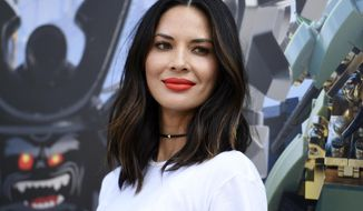 """FILE - In this July 21, 2017 file photo, actress Olivia Munn attends """"The Lego Ninjago Movie"""" photo op at Comic-Con International in San Diego. Munn along with five other women have accused film director Brett Ratner of sexual harassment or misconduct in a Los Angeles Times report. (Photo by Richard Shotwell/Invision/AP, File)"""