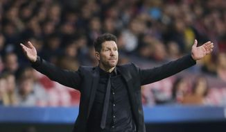 Atletico coach Diego Simeone gestures during a Group C Champions League soccer match between Atletico Madrid and Qarabag at the Metropolitano stadium in Madrid, Spain, Tuesday, Oct. 31, 2017. (AP Photo/Paul White)