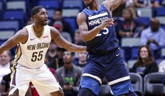 Minnesota Timberwolves guard Jimmy Butler (23) works against New Orleans Pelicans guard E'Twaun Moore (55) in the first half of an NBA basketball game in New Orleans, Wednesday, Nov. 1, 2017. (AP Photo/Scott Threlkeld)