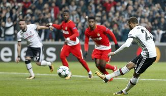Besiktas' Cenk Tosun, right, scores his side's opening goal from penalty during the Champions League group G soccer match between Besiktas and Monaco at the Besiktas Park stadium in Istanbul, Wednesday, Nov. 1, 2017. (AP Photo/Lefteris Pitarakis)