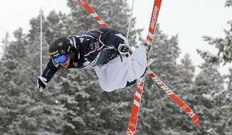 """FILE - In this Feb. 2, 2017, file phot,o, Benjamin Cavet, of France, competes in men's moguls at the World Cup freestyle skiing competition at Deer Valley resort in Park City, Utah. The 23-year-old wants to land a jump at the Olympics that no-one has successfully performed in competition: the devilishly difficult off-axis quadruple spin known as the """"cork 1440.""""  (AP Photo/Rick Bowmer, File)"""