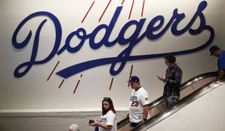 Fans make their way around Dodgers Stadium before Game 6 of baseball's World Series between the Houston Astros and the Los Angeles Dodgers Tuesday, Oct. 31, 2017, in Los Angeles. (AP Photo/Jae C. Hong)