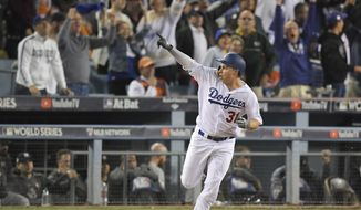 Los Angeles Dodgers' Joc Pederson celebrates his home run off against the Houston Astros during the seventh inning of Game 6 of baseball's World Series Tuesday, Oct. 31, 2017, in Los Angeles. (AP Photo/Mark J. Terrill)