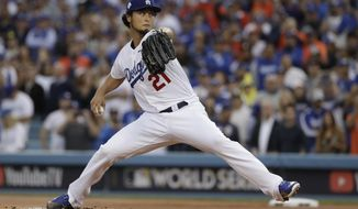 Los Angeles Dodgers starting pitcher Yu Darvish throws during the first inning of Game 7 of baseball's World Series against the Houston Astros Wednesday, Nov. 1, 2017, in Los Angeles. (AP Photo/Matt Slocum)
