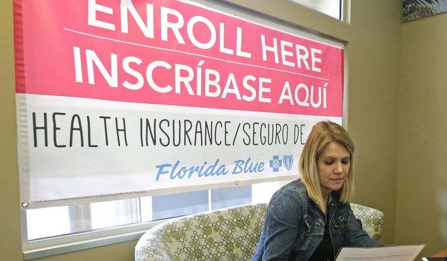 Catherine Reviati reviews the different Affordable Care Act enrollment options, Thursday, Nov. 2, 2017, in Hialeah, Fla. (AP Photo/Alan Diaz) ** FILE **