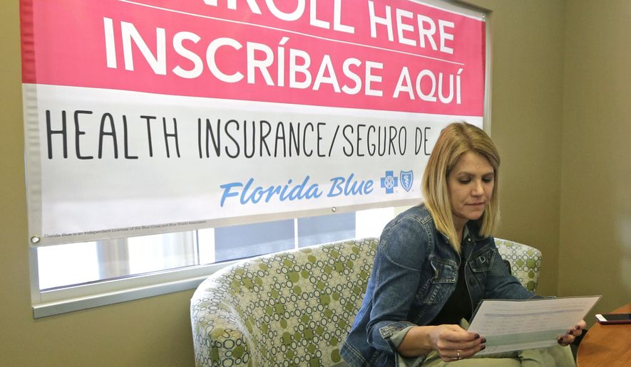 Catherine Reviati reviews Affordable Care Act enrollment options in Florida. States that run their own Obamacare markets say they are seeing a surge of interest this year. (Associated Press/File)