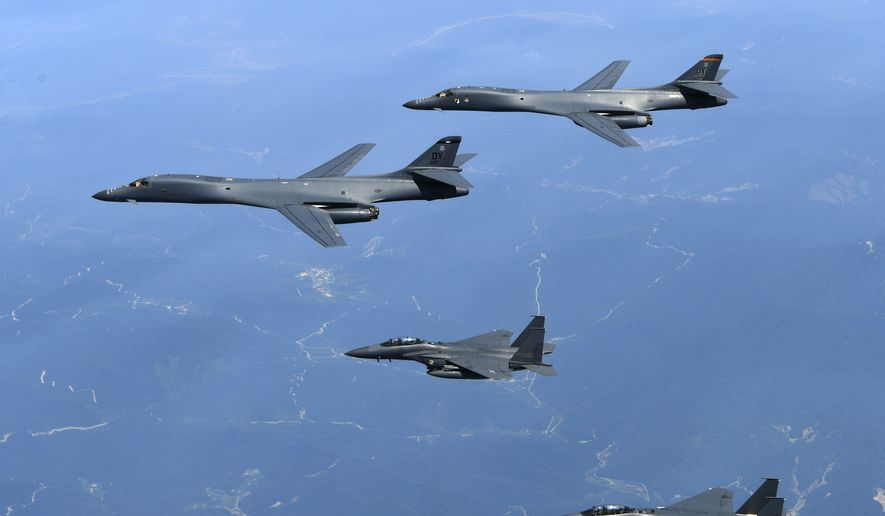 In this June 20, 2017, file photo provided by South Korean Defense Ministry, U.S. Air Force B-1B bombers, top, and second from top, and South Korean fighter jets F-15K fly over the Korean Peninsula, South Korea. A South Korean military official said Friday, Nov. 3, 2017, the B-1B bombers based in Guam were escorted by two South Korean F-16 fighter jets during the drills Thursday at a field near the South's eastern coast. The drills simulated attacks on land targets, but didn't involve live weapons, said the official, who did not want to be named, citing office rules. (South Korean Defense Ministry via AP, File)