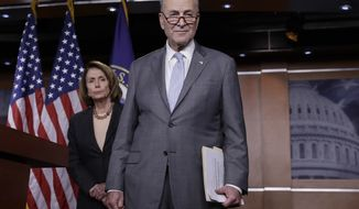 House Minority Leader Nancy Pelosi, D-Calif., left, and Senate Minority Leader Chuck Schumer, D-N.Y., take questions during a news conference on Capitol Hill to respond to the Republican tax reform plan in Washington, Thursday, Nov. 2, 2017. (AP Photo/J. Scott Applewhite)