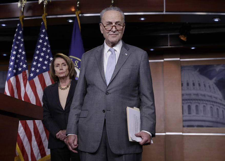 In this file photo, House Minority Leader Nancy Pelosi, D-Calif., left, and Senate Minority Leader Chuck Schumer, D-N.Y., take questions during a news conference on Capitol Hill to respond to the Republican tax reform plan in Washington, Thursday, Nov. 2, 2017. (AP Photo/J. Scott Applewhite) **FILE**