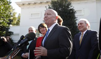 House Ways and Means Chairman Rep. Kevin Brady, R-Texas, speaks with reporters, with other committee members including House Majority Whip Steve Scalise, R-La., right, after a meeting with President Donald Trump at the White House, Thursday, Nov. 2, 2017, in Washington. (AP Photo/Alex Brandon)