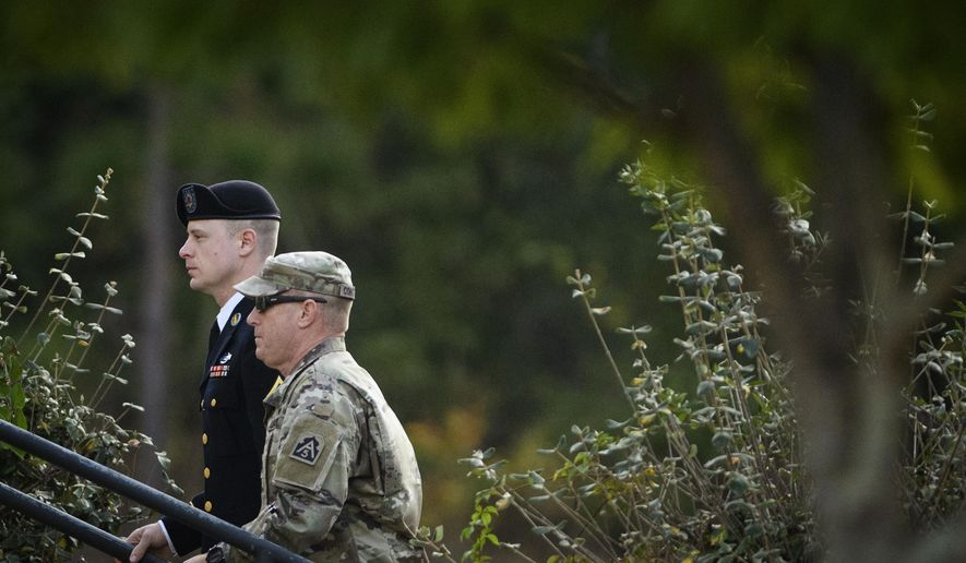 Army Sgt. Bowe Bergdahl, left, arrives at the Fort Bragg courtroom facility for a sentencing hearing on Wednesday, Nov. 1, 2017, on Fort Bragg, N.C. Bergdahl, who walked off his base in Afghanistan in 2009 and was held by the Taliban for five years, pleaded guilty to desertion and misbehavior before the enemy. (Andrew Craft /The Fayetteville Observer via AP)
