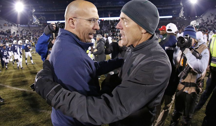 FILE - In this Nov. 29, 2014, file photo, Penn State head coach James Franklin, left, and Michigan State head coach Mark Dantonio meet on the field after a 34-10 Michigan State win in an NCAA college football game in State College, Pa. No. 7 Penn State visits No. 24 Michigan State in a game in which both teams are looking to bounce back from losses while playing for the Land Grant Trophy.  (AP Photo/Gene J. Puskar, File)