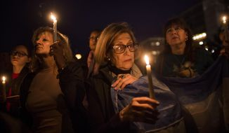 """People gather to remember the victims of the recent truck attack during a candle light walk along Hudson River coast near the crime scene on Thursday, Nov. 2, 2017, in New York. A man in a rented pickup truck mowed down pedestrians and cyclists along the busy bike path near the World Trade Center memorial on Tuesday, killing at least eight and seriously injuring others in what the mayor called """"a particularly cowardly act of terror."""" (AP Photo/Andres Kudacki)"""
