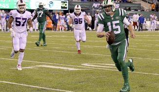 New York Jets quarterback Josh McCown (15) scrambles for a touchdown run as Buffalo Bills outside linebacker Lorenzo Alexander (57) and defensive tackle Kyle Williams (95) chase him during the first half of an NFL football game, Thursday, Nov. 2, 2017, in East Rutherford, N.J. (AP Photo/Bill Kostroun)
