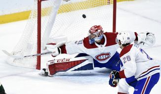 Montreal Canadiens' Jeff Petry (26) watches a goal by Minnesota Wild left wing Tyler Ennis get past Canadiens goalie Carey Price (31) during the first period of an NHL hockey game Thursday, Nov. 2, 2017, in St. Paul, Minn. (AP Photo/Hannah Foslien)