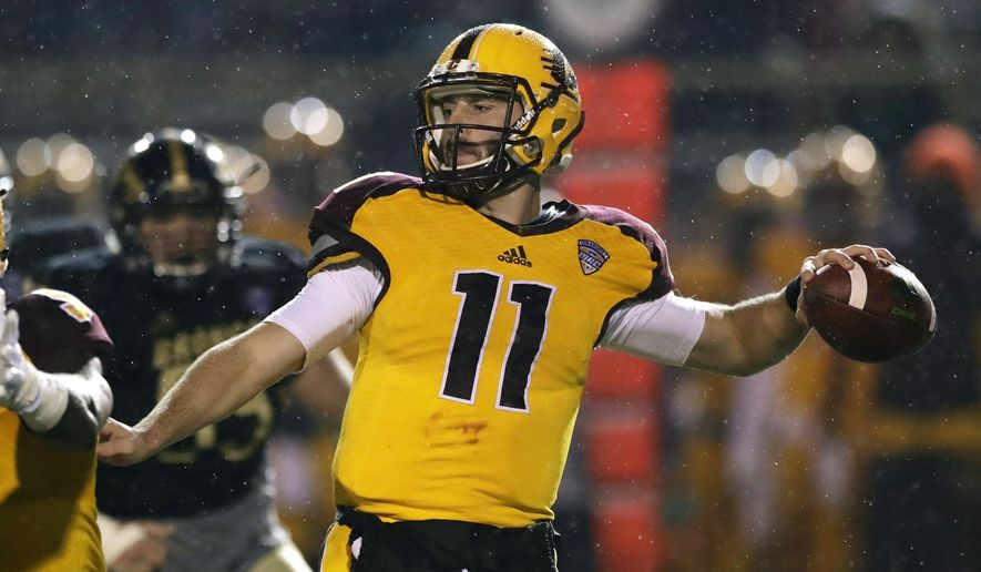 Central Michigan quarterback Shane Morris throws during the first half of an NCAA college football game against Western Michigan, Wednesday, Nov. 1, 2017, in Kalamazoo, Mich. (AP Photo/Carlos Osorio)