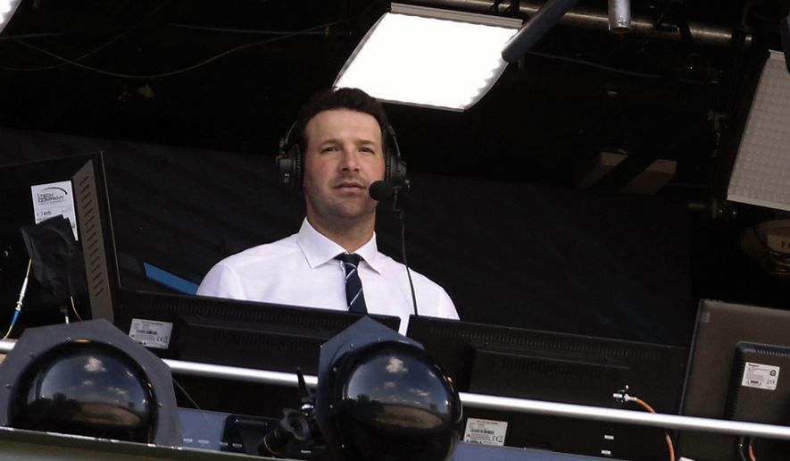 In this Sept. 24, 2017, file photo, Tony Romo sits in the broadcast booth during the first half of an NFL football game between the Green Bay Packers and the Cincinnati Bengals in Green Bay, Wis. Romo, the Dallas franchise leader in passing yards and touchdowns, will soon call his first Cowboys game as the lead analyst for CBS. (AP Photo/Mike Roemer, File)