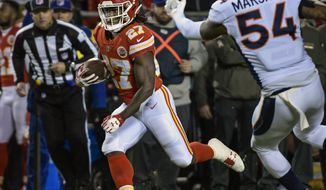 FILE - In this Oct. 30, 2017, file photo, Kansas City Chiefs running back Kareem Hunt (27) runs past Denver Broncos inside linebacker Brandon Marshall (54) during the first half of an NFL football game in Kansas City, Mo. Hunt does not mind admitting he is a little disappointed that he likely will not share the field with Ezekiel Elliott when Kansas City visits Dallas.(AP Photo/Reed Hoffmann, File)