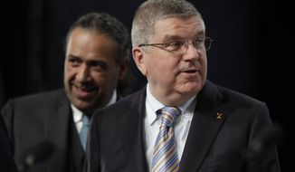 ANOC president Sheikh Ahmad Al Fahad Al Sabah of Kuwait, left, and IOC President Thomas Bach, right, arrive at the general assembly of The Association of National Olympic Committees in Prague, Czech Republic, Thursday, Nov. 2, 2017. (AP Photo/Petr David Josek)