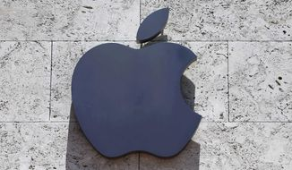 FILE - This Tuesday, Aug. 8, 2017, file photo shows the Apple logo at a store in Miami Beach, Fla. Apple Inc. reports earnings Thursday, Nov. 2, 2017. (AP Photo/Alan Diaz, File)