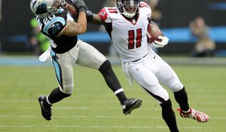 FILE - In this Dec. 24, 2016, file photo, Atlanta Falcons' Julio Jones (11) pushes away Carolina Panthers' Kurt Coleman (20) after a catch in the second half of an NFL football game in Charlotte, N.C. Jones has had a very quiet year by his own standards with only one 100-yard game and one touchdown this season.  But facing the Panthers on Sunday, Nov. 5, 2017, could be the cure to those issues. Jones has 25 receptions for 538 yards and two TDs in his last three meetings with Carolina. (AP Photo/Mike McCarn)