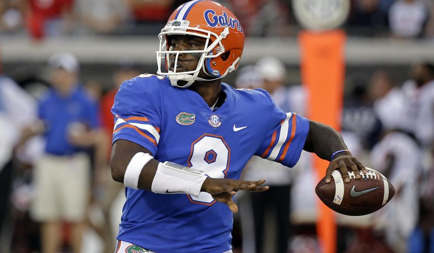 FILE - In this Oct. 28, 2017, file photo, Florida quarterback Malik Zaire looks for a receiver against Georgia in the second half of an NCAA college football game, in Jacksonville, Fla. Florida will start its third quarterback of the season Saturday at Missouri. Interim coach Randy Shannon announced Thursday, Nov. 2, 2017,  that graduate transfer Malik Zaire will start against the Tigers, a game the Gators probably need to win to make a bowl. (AP Photo/John Raoux, File)