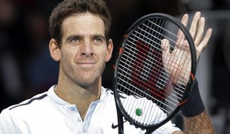 Juan Martin del Potro of Argentina acknowledges applauses after he defeated Robin Haase of the Netherlands during the third round of the Paris Masters tennis tournament at the Bercy Arena in Paris, France, Thursday, Nov. 2, 2017. (AP Photo/Michel Euler)