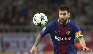Barcelona's Lionel Messi controls the ball during the Champions League group D soccer match between Olympiakos and Barcelona at Georgios Karaiskakis stadium at Piraeus port, near Athens, Tuesday, Oct. 31, 2017. (AP Photo/Petros Giannakouris)