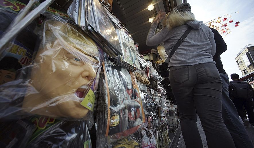 Some rubber masks including of U.S. President Donald Trump are sold in Tokyo Thursday, Nov. 2, 2017.  During his first months as president, Trump, who will visit Japan, South Korea and China before attending regional summits in Vietnam and the Philippines, has blended moments of flattery with vows to rip up trade deals, destroy a sovereign nation with nuclear weapons and generally crash long-standing norms of diplomacy anywhere it suits his aims. (AP Photo/Eugene Hoshiko)
