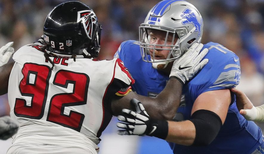 FILE - In this Sept. 24, 2017, file photo, Detroit Lions offensive guard T.J. Lang, right, blocks Atlanta Falcons defensive tackle Dontari Poe (92) during an NFL football game in Detroit. Lang, who played for the Green Bay Packers from 2009-2016, will play against his former team on Monday, Nov. 6. (AP Photo/Paul Sancya, File)