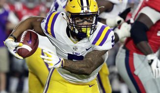 FILE - In this Oct. 21, 2017, file photo, LSU running back Derrius Guice (5) runs through Mississippi defenders for a long gain in the first half of an NCAA college football game in Oxford, Miss. No. 19 LSU could sure use a career-defining performance from record-setting Guice when the Tigers visit No. 1 Alabama this week/ (AP Photo/Rogelio V. Solis, File)
