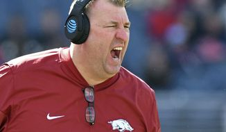 FILE - In this Saturday, Oct. 28, 2017, file photo, Arkansas head coach Bret Bielema shouts during the second half of an NCAA college football game against Mississippi in Oxford, Miss. Florida became the first Power Five program this season to make a coaching, but several more enter the last month of the season faced with what could be a hard choice. Arkansas has a record of 3-5.  (AP Photo/Thomas Graning, File)