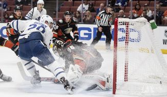Toronto Maple Leafs right wing Connor Brown, left, scores past Anaheim Ducks goalie John Gibson during the first period of an NHL hockey game Wednesday, Nov. 1, 2017, in Anaheim, Calif. (AP Photo/Kyusung Gong)