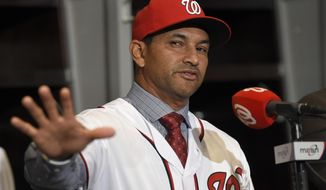 New Washington Nationals manager Dave Martinez gestures during a baseball press conference, Thursday, Nov. 2, 2017, in Washington. (AP Photo/Nick Wass)