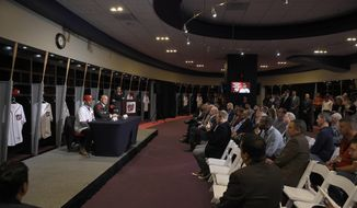 Washington Nationals manager Dave Martinez, left, speaks alongside general manager Mike Rizzo during a baseball press conference, Thursday, Nov. 2, 2017, in Washington. (AP Photo/Nick Wass)
