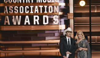 FILE - This Nov. 2, 2016 file photo shows hosts Brad Paisley, left, and Carrie Underwood at the 50th annual CMA Awards in Nashville, Tenn. The Country Music Association is warning media outlets to avoid questions about a recent mass shooting in Las Vegas, gun rights or political affiliations at their annual awards show next week or risk losing credentials. The 51st annual CMA Awards will air live on Wednesday. (Photo by Charles Sykes/Invision/AP, File)
