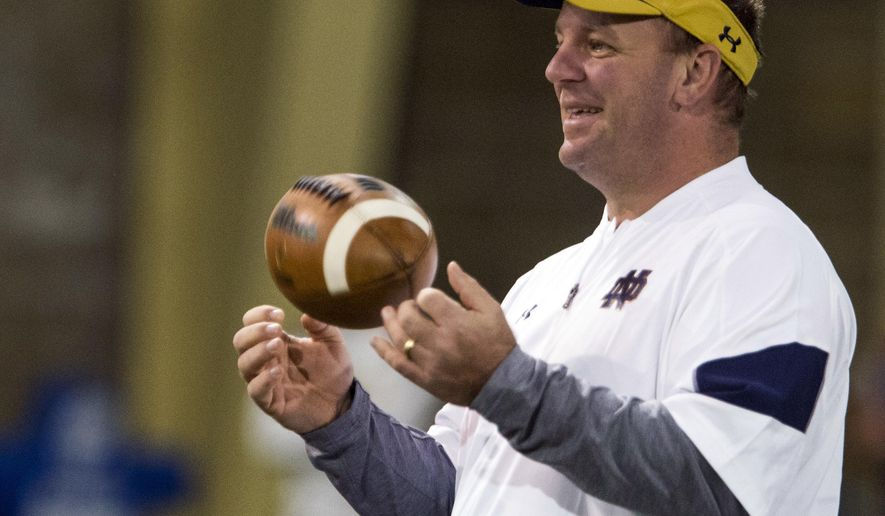 FILE - In this March 22, 2017, file photo, Notre Dame defensive coordinator Mike Elko runs drills during NCAA college football practice in South Bend, Ind. Elko will find himself this weekend across the field facing a group of players he once recruited to a program he helped build. Elko spent the last three seasons as the defensive coordinator at Wake Forest, which visits the fifth-ranked Fighting Irish on Saturday. (Becky Malewitz/South Bend Tribune via AP, File)