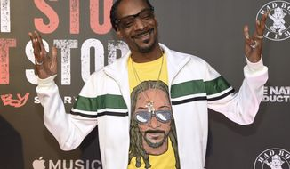 """FILE - In this Wednesday, June 21, 2017, file photo, Snoop Dogg arrives at the Los Angeles premiere of """"Can't Stop, Won't Stop: A Bad Boy Story"""" at the Writers Guild Theater on in Beverly Hills, Calif. An album cover image posted to Snoop Dogg's Instagram account on Oct. 31, 2017, showing the rapper looking down on what appears to be the dead body of President Donald Trump has been removed from the platform. (Photo by Chris Pizzello/Invision/AP, File)"""