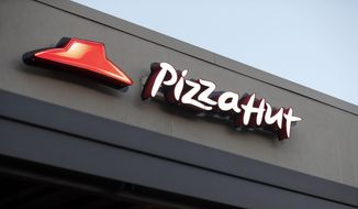 This Thursday, Dec. 15, 2016, file photo shows a Pizza Hut restaurant in New Orleans. (AP Photo/Gerald Herbert, File)