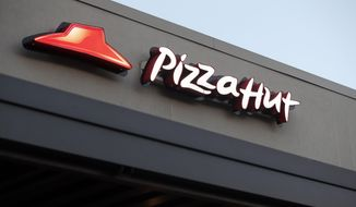 FILE - This Thursday, Dec. 15, 2016, file photo shows a Pizza Hut restaurant in New Orleans. On Thursday, Nov. 2, 2017, Yum Brands said it saw a key sales measure rise at KFC, Pizza Hut and Taco Bell for the third quarter, and said it saw no effect on sales due to declining NFL viewership, a day after Papa John's blamed weaker pizza sales on the controversy over protests during the national anthem. (AP Photo/Gerald Herbert, File)