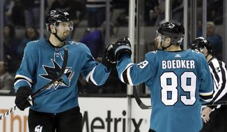 San Jose Sharks' Marc-Edouard Vlasic, left, celebrates his goal with teammate Mikkel Boedker (89) during the second period of an NHL hockey game against the Nashville Predators, Wednesday, Nov. 1, 2017, in San Jose, Calif. (AP Photo/Marcio Jose Sanchez)