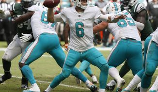 In this Oct. 22, 2017, photo, Miami Dolphins quarterback Jay Cutler (6) looks to pass, during the first half of an NFL football game against the New York Jets in Miami Gardens, Fla. The Raiders play at Miami on Sunday night, and both teams are reeling. The Raiders have lost five of their past six games, including a 34-14 thumping last Sunday at Buffalo. The Dolphins are coming off a 40-0 loss at Baltimore, their worst defeat in 20 years. (AP Photo/Wilfredo Lee)