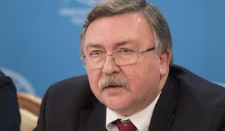 Mikhail Ulyanov, head of the Russian Foreign Ministry's arms control and non-proliferation department, speaks at a news conference in Moscow, Russia, Thursday, Nov. 2, 2017. Ulyanov said Russia would welcome the extension of the U.N.-sponsored investigations into chemical weapons use in Syria, but considers it necessary to amend the ground rules for them. (AP Photo/Pavel Golovkin)