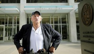 "FILE - In this Tuesday, Oct. 20, 2015, file photo, former Minnesota Gov. Jesse Ventura talks to reporters at the Warren E. Burger Federal Building and United States Courthouse after a defamation hearing, in St. Paul, Minn. Ventura and the estate of ""American Sniper"" author Chris Kyle are apparently working toward a settlement in Ventura's yearslong defamation case. (Elizabeth Flores/Star Tribune via AP)"