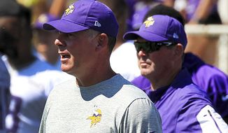 In this July 27, 2017, file photo, Minnesota Vikings offensive coordinator Pat Shurmur, left, and head coach Mike Zimmer watch practice during NFL football training camp in Mankato, Minn. The Vikings have managed to withstand the loss of their starting quarterback and running back in the first quarter of the season with a balanced attack, quality depth and a vastly improved offensive line. Coordinator Pat Shurmur has quietly done a masterful job of keeping the offense running. (AP Photo/Andy Clayton-King, File)