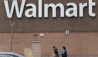 Employees head in to a Walmart store Thursday, Nov. 2, 2017, in Thornton, Colo. A man suspected of fatally shooting several inside the suburban Denver Walmart on Wednesday, was arrested 14 hours later following a brief car chase Thursday that ended at a congested intersection, police said. (AP Photo/David Zalubowski)