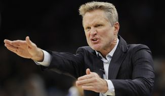 Golden State Warriors head coach Steve Kerr argues a call during the first half of an NBA basketball game against the San Antonio Spurs, Thursday, Nov. 2, 2017, in San Antonio. (AP Photo/Eric Gay)