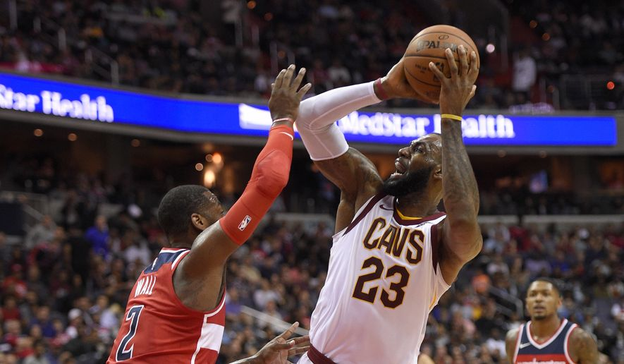 Washington Wizards guard John Wall (2) defends Cleveland Cavaliers forward LeBron James (23) during the first half of an NBA basketball game, Friday, Nov. 3, 2017, in Washington. (AP Photo/Nick Wass)
