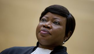 In this Tuesday, Sept. 29, 2015, file photo, prosecutor Fatou Bensouda looks on in the court room of the International Criminal Court in The Hague, Netherlands. The chief prosecutor for the International Criminal Court said Friday, Nov. 3, 2017, she is seeking an investigation of alleged war crimes committed in the war in Afghanistan, an unprecedented probe that could encompass United States troops. (AP Photo/Peter Dejong, file)