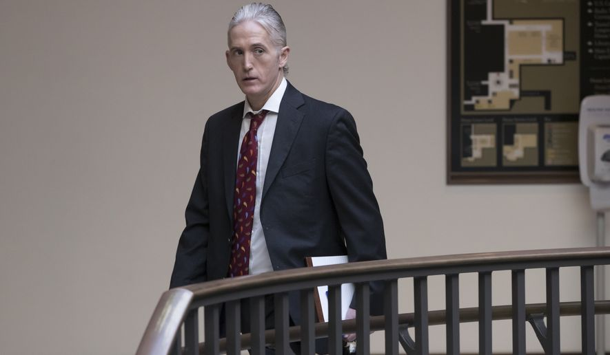 Rep. Trey Gowdy, R-S.C., a member of the House Intelligence Committee, heads to a closed-door session with former acting Attorney General Sally Yates, on Capitol Hill in Washington, Friday, Nov. 3, 2017. Yates was the first to alert the White House to problems with ex-national security adviser Michael Flynn. (AP Photo/J. Scott Applewhite)